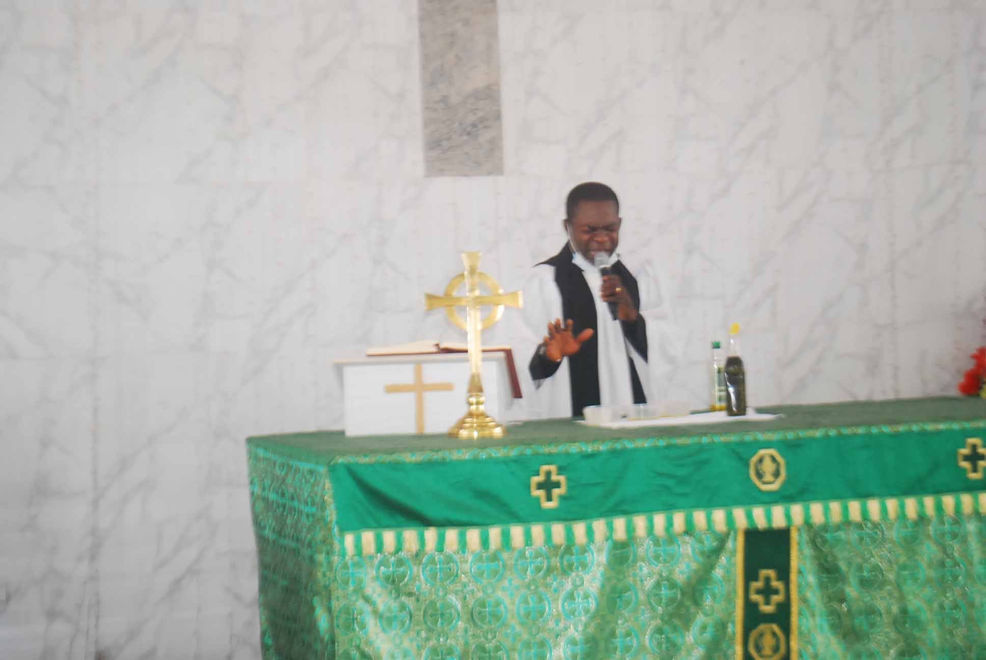 Ven. Dr. Louis Ochei, Anointing the Oil