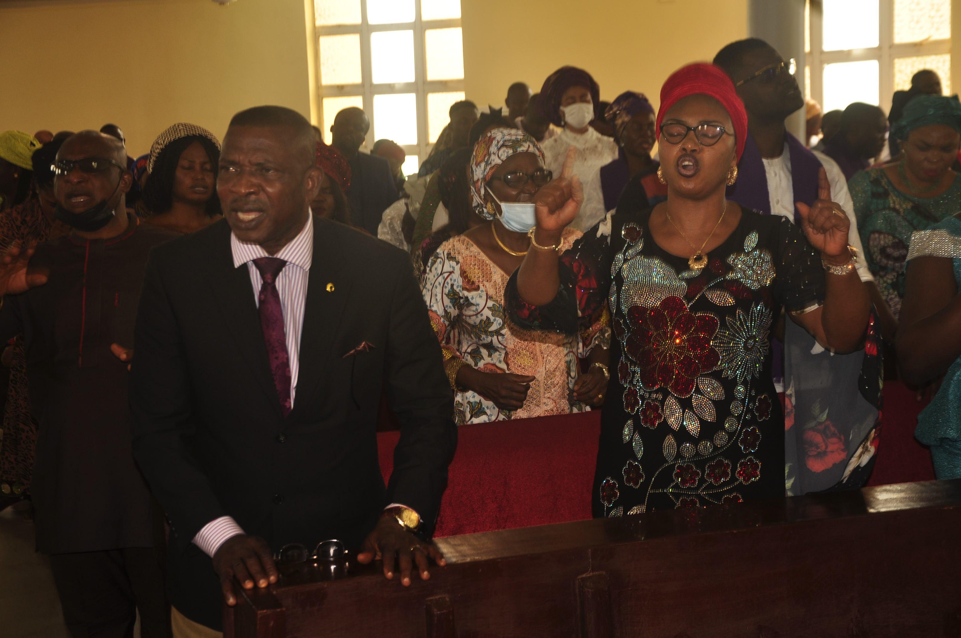 Mr. Friday Akpata and a Church member...